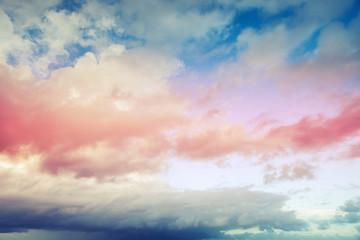 Blue and red cloudy sky background, toned filter effect