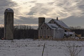 Snowy Barn and Silo at Dusk