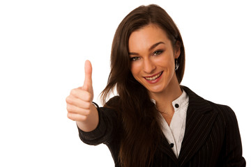 Besutiful business woman gesturing success with showing thumb up