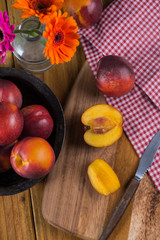 fresh nectarine peach cut on rustic board