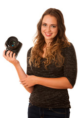 Pretty asian caucasian woman with camera in her hands smiling is