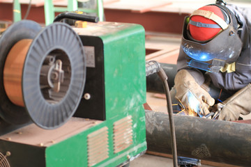 welder is welding pipe structure with all safety