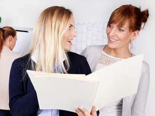 Business women talking about a contract