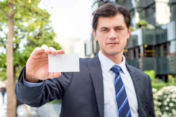 Businessman is holding greeting card