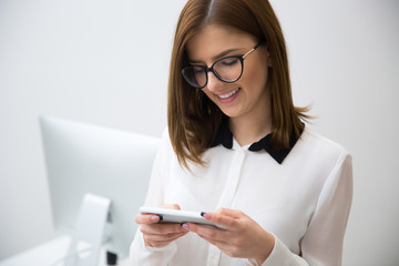 Portrait of beautiful businesswoman using smartphone