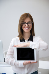 Happy businesswoman showing tablet computer screen