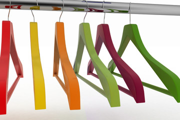 Row of color coat hangers on metal clothes rail