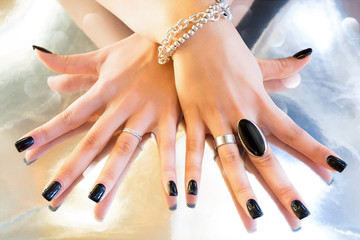 dark manicure with metal accessories
