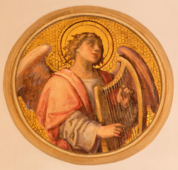 Vienna - fresco of angel with the zither in Muttergotteskirche.
