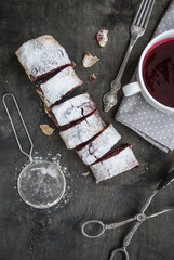Cherry and walnut strudel on a dark wooden  table. Selective foc