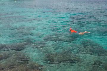 Man snorkeling in blue Indian ocean