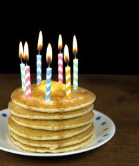 birthday candles on pancake stack