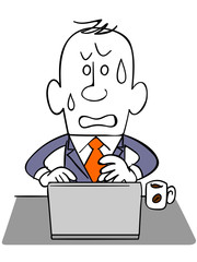 ノートパソコンを使うビジネスマン_焦り