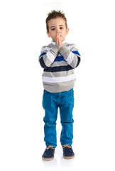 Kid pleading over white background