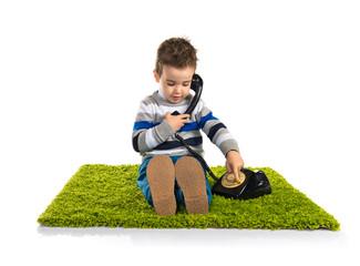 Kid talking to vintage phone