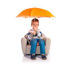 Kid holding an umbrella
