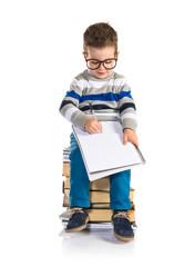 Student kid sitting on books