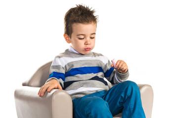 Kid eating sweet