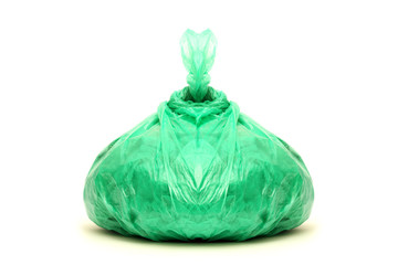 Green rubbish bag isolated on white