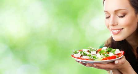 Young woman with plate of salad