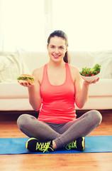 smiling teenager with green salad and hamburger