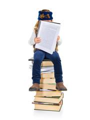 Student little girl sitting on books