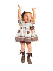 Little blonde girl jumping over white background