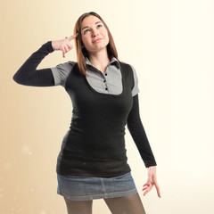 Woman making a crazy gesture over white background