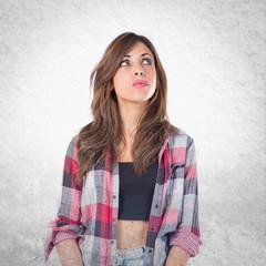 Girl thinking over isolated white background