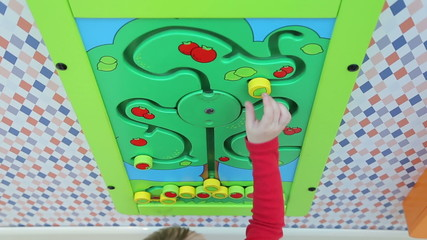 Girl playing educational games, set in a shopping center