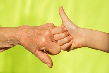 hand of senior and child
