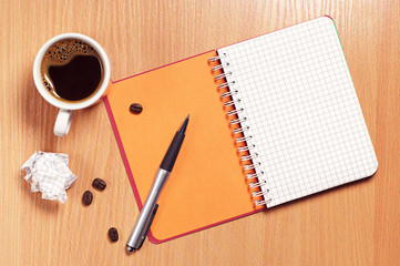 Coffee cup and notepad