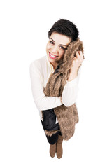 Woman holding soft fur jacket against her cheek