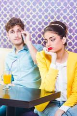 Woman gets bored while her date is talking on the phone