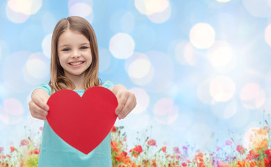 smiling girl with red heart natural background
