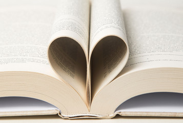 Book pages curved into heart shape