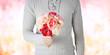 Obrazy na płótnie, fototapety, zdjęcia, fotoobrazy drukowane : close up of man holding flowers