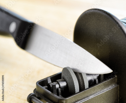 Sharpening of knife in a kitchen - 76500894