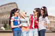 happy teenage girls or young women talking