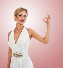 Smiling woman showing ok sign