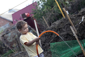 Child watering seedling