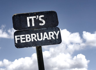 It's February sign with clouds and sky background
