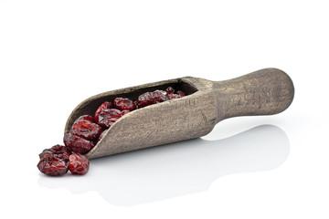 Żurawina na drewnianej łyżce