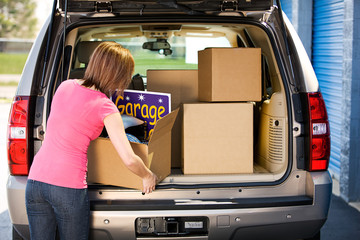 Storage: Woman Packing Away Garage Sale Leftovers