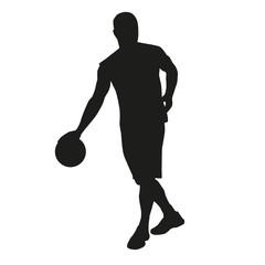 Dribbling basketball player