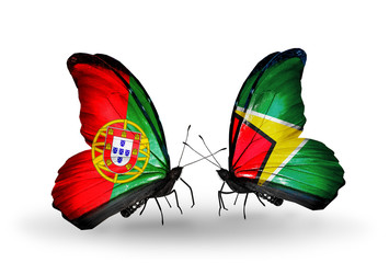 Two butterflies with flags Portugal and Guyana