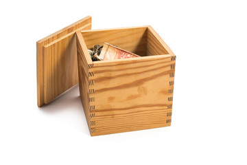 wooden box filled with money
