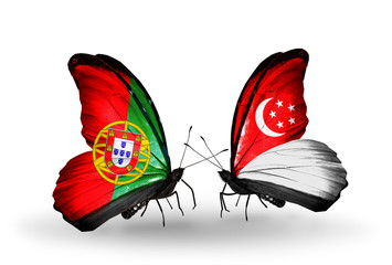 Two butterflies with flags Portugal and Singapore