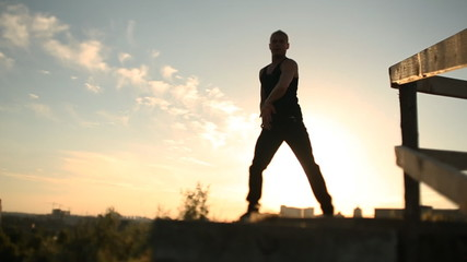 Man dancing at sunset