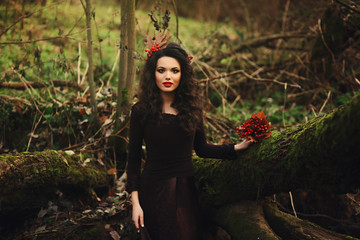 Portrait of romantic young woman in fairy forest